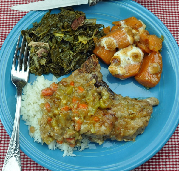 Smothered Pork Chops, Greens and Sweet Potatoes — Soul Food style.