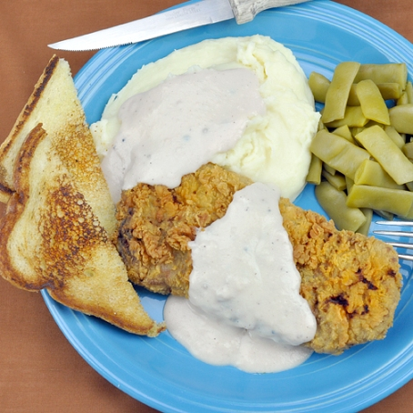 Chicken Fried Steak — served with the requisite Mashed Potatoes & Gravy; and toast for sopping.